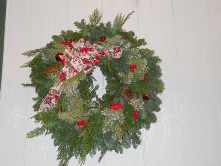 A Christmas wreath would look amazing on your front door. Welcome your guests with holiday cheer by adding a custom made wreath to your home decor.